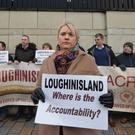 Emma Rogan, daughter of Adrian Rogan, with other families and supporters of the Loughinisland victims at Belfast High Court