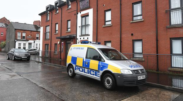 Police at London Road, east Belfast, where Mark Ponisi was found dead