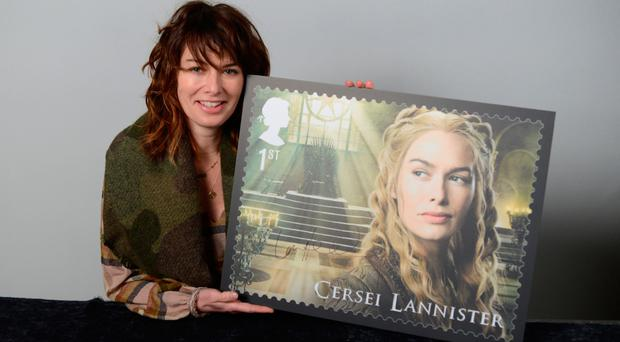 Lena Headey with the stamp showing her character Cersei Lannister