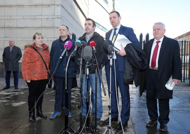 Family members of Gary Haggarty's victims outside court including (second from left) the son of John Harbinson, Aaron, and the son of Eamon Fox, Keiran (centre)