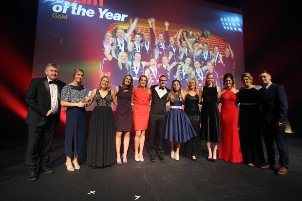 Northern Ireland legend Norman Whiteside (left) presents the NI netball team with their Team of the Year Gold prize at the Belfast Telegraph Sports Awards last night. Included is sponsor Gary Sinnerton, MD The Home Design Group while