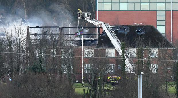 Firefighters deal with the major fire at Palace Barracks