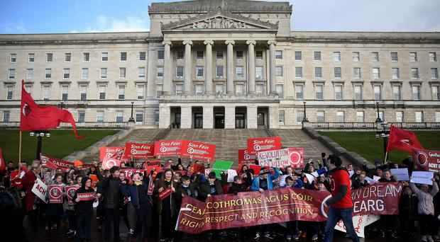 Irish language act campaigners, including school pupils protest at Stormont. (Brian Lawless/PA)