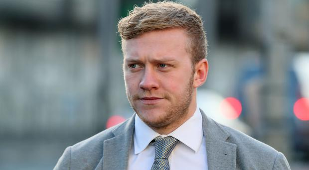 Ireland and Ulster rugby player Stuart Olding arrives at Belfast Crown Court . (Brian Lawless/PA)
