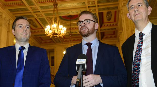 DUP's Simon Hamilton and party colleagues at Stormont yesterday