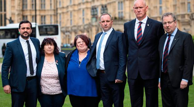 From left: lawyer Matt Jury, Judith Jenkins (widow of Jeffrey Young who was killed by the 1982 IRA Hyde Park bomb), her daughter Sarahjane Young, Mark Tipper (brother of Trooper Simon Tipper also killed in the bomb attack), survivor Simon Utley and Danny Kinahan MP outside the Houses of Parliament. The families have been granted legal aid to pursue a civil case against the bombing suspect