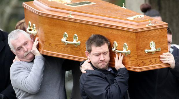 Friends and family carry the coffin of Norman Prentice from St John's Church yesterday