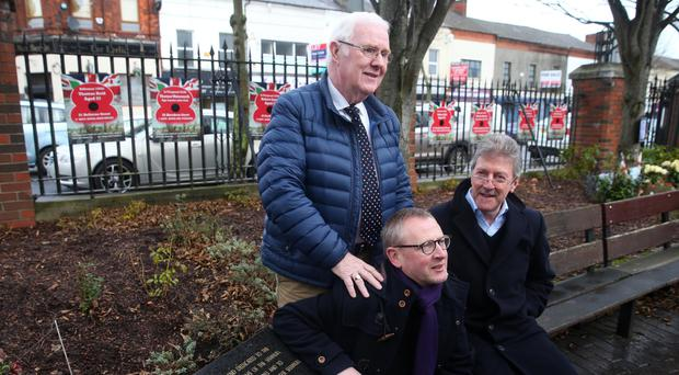Stephen Travers (badly injured in Miami Showband attack), Alan McBride (whose wife died in the Shankill bombing) and Eugene Reavey (whose brother was killed during the Troubles) at the Shankill Road Bomb Memorial Garden in Belfast