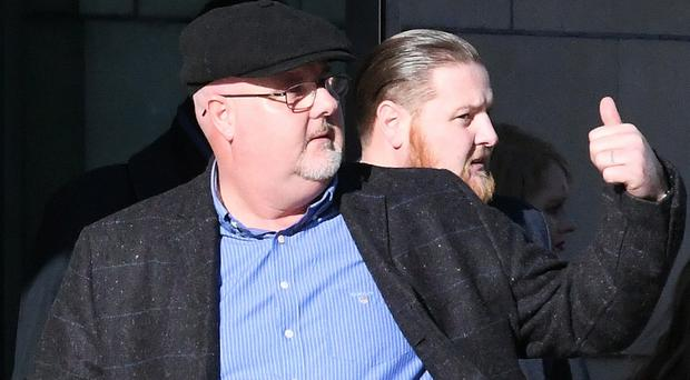 Patrick McGinley Snr (left) and William McGinley leave Belfast Crown Court yesterday