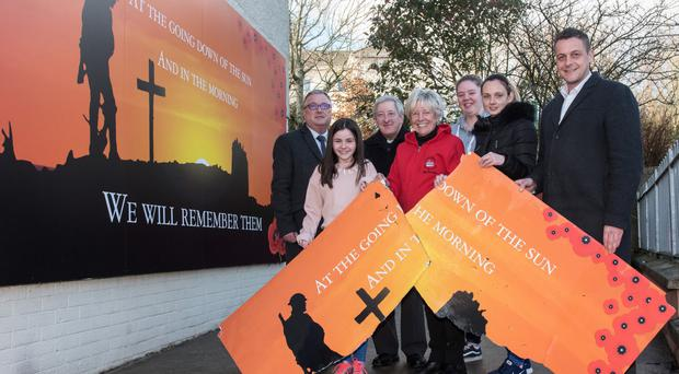 Councillor Graeme Warke (right)at the replacement mural in the Fountain Estate. Included (from left) are Eddie Doherty, NIHE area manager; Katelyn Warke, Cathedral Youth Club; Dean Raymond Stewart, St Columb's Cathedral; Jeanette Warke, Cathedral Youth Club; Britney Hetherington and Alexis Curry, Cathedral Youth Club