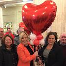 Michelle O'Neill and Mary Lou McDonald with party colleagues on Valentine's Day at Stormont (David Young/PA)