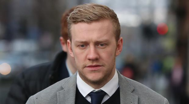 Stuart Olding arrives at Belfast Crown Court (Niall Carson/PA)