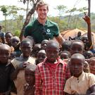 Oxfam Ireland ambassador Andrew Trimble with children in the Nduta refugee camp in Tanzania