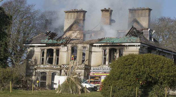 Firefighters at the scene of the blaze which destroyed Donaghmore House on the outskirts of Castlefin, in Co Donegal