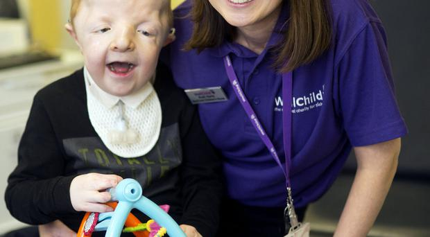 Little Daire Flanaghan has a special smile for WellChild nurse Ruth
