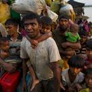 Rohingya Muslims cross the border from Burma into Bangladesh (Bernat Armangue/AP)