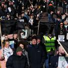 Victims and relatives of those killed in Troubles-related incidents marched to Belfast City Hall (Brian Lawless/PA)