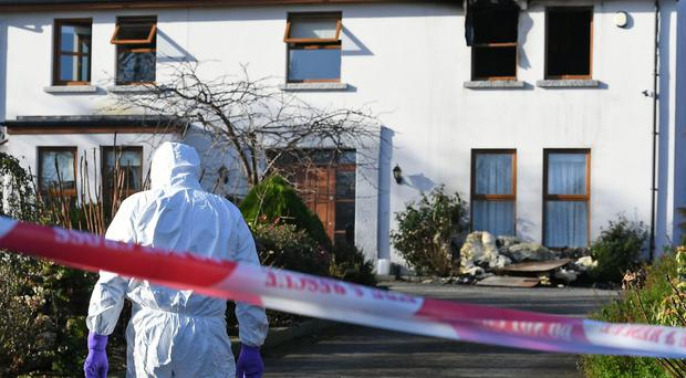 Forensic experts at the scene of the burglary last week