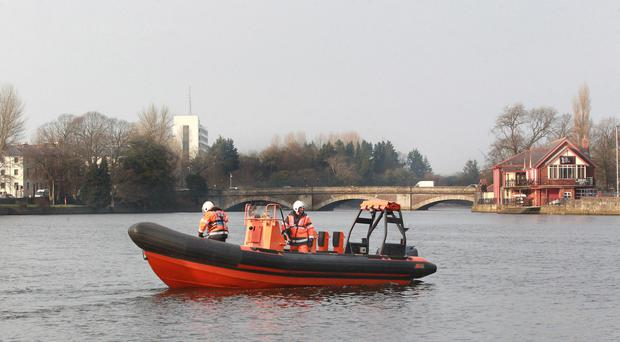 Rescue workers search the River Bann in Coleraine for Kerry Millar