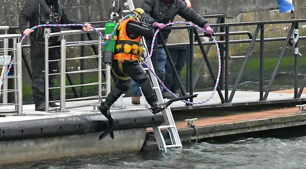 A diver enters the water at Lagan Weir