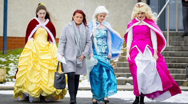 Mourners, some dressed as Disney princesses, at the funeral of Lacey Pollock