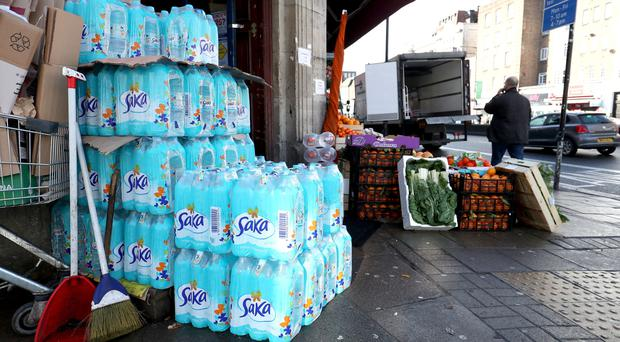 Stacks of bottled water outside a convenience store at the junction of Wyatt Park Road and Streatham Hill in London (Jonathan Brady/PA)