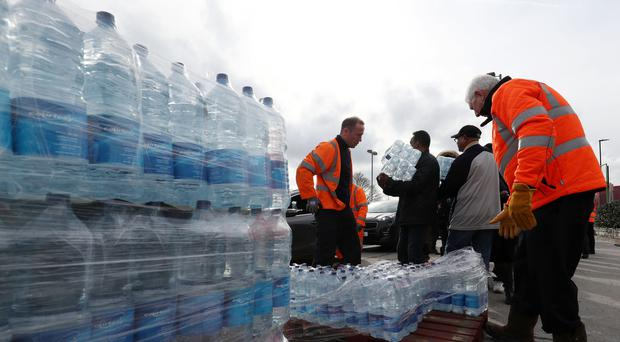 A bottled water station set up by Thames Water outside Homebase Streatham (Jonathan Brady/PA)