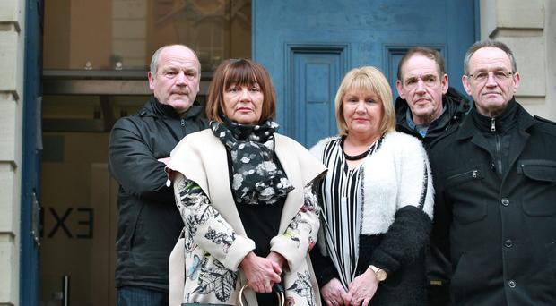 The children of Kathleen Thompson, from left: Ernie, Minty (Marie Louise), Patricia, Billy and Davy outside Derry Court yesterday for the inquest into their mother's death