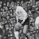 Bobby Moore wins the ball from George Best