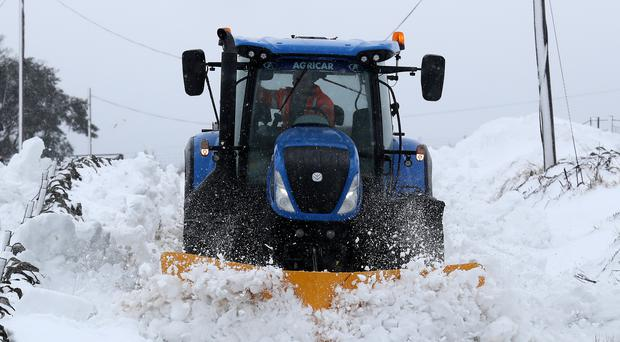 A farmer struggles in the snow (Andrew Milligan/PA)