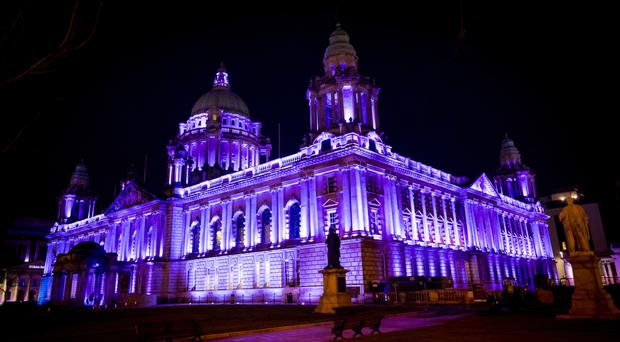 Belfast City Hall lit up in purple for International Women's Day yesterday