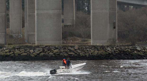 A speedboat helps with a search on the River Foyle.
