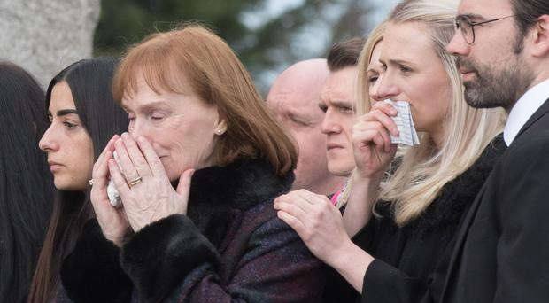 Karol Kelly's mother Philomena (second left) at the funeral yesterday