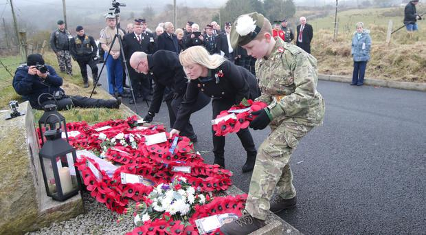 A wreath-laying ceremony at the memorial in Ligoniel to the three soldiers