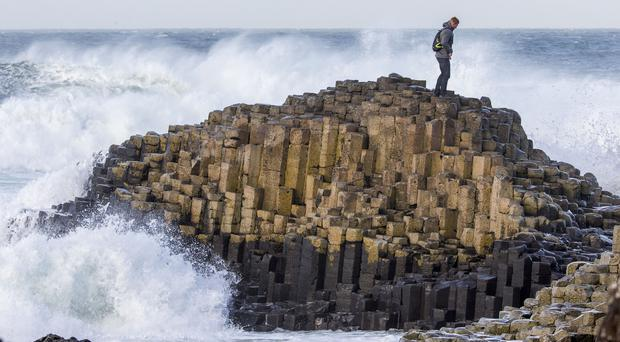 A tourist at Giants Causeway in Northern Ireland (Liam McBurney/PA)