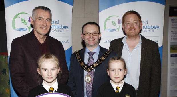 Paul Hamill with Sinn Fein MLA Declan Kearney (left), Sean O Murchadha, and Iona Gorman and Meabh McClean from Gaelscoil Eanna