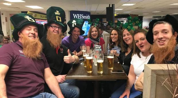Tony Breen (second on left) with wife Tricia (third from right) and friends from Armoy at Belfast International Airport yesterday