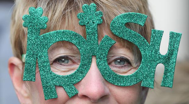 A woman watches the St Patrick's Day parade in New York City (Niall Carson/PA)