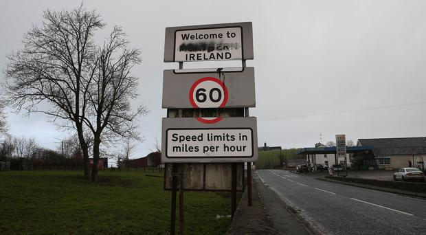 A vandalised 'Welcome to Northern Ireland' sign