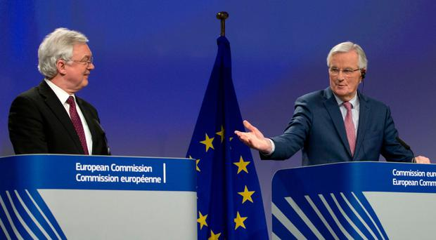 European Union chief Brexit negotiator Michel Barnier (right) and British Secretary of State for Exiting the European Union David Davis participate in a media conference at EU headquarters in Brussels yesterday