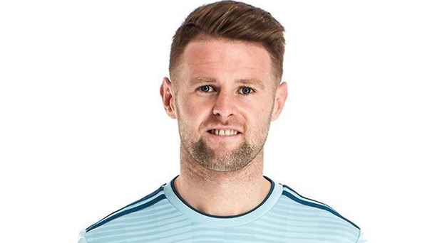 Northern Ireland player Oliver Norwood models the new away kit
