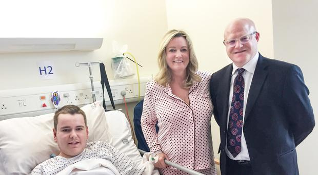 Mark Dobson, with mum Jo-Anne and surgeon Tim Brown following the successful operation