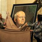 The portrait of former deputy first minister Martin McGuinness is unveiled by family members including his wife Bernadette in the Great Hall of Parliament Buildings, Stormont (Brian Lawless/PA)