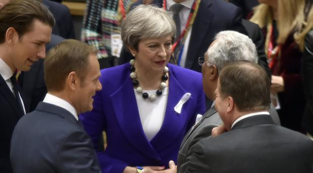 Theresa May speaks with from left, Austrian Chancellor Sebastian Kurz, European Council President Donald Tusk, Swedish Prime Minister Stefan Lofven and Portuguese Prime Minister Antonio Costa (Eric Vidal, Pool Photo via AP)