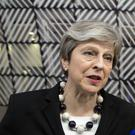Theresa May speaks with the media as she arrives for the EU in Brussels (Virginia Mayo/AP)