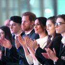 Prince Harry and Meghan Markle join guests during a visit to the Eikon Exhibition Centre in Lisburn (Niall Carson/PA)