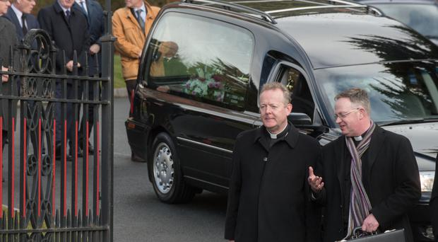 Archbishop Eamon Martin (left), Primate of all Ireland, at the funeral of his mother, Catherine Martin, at St Patrick's Church in Derry