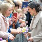 Meghan Markle chats to the crowds in Belfast yesterday