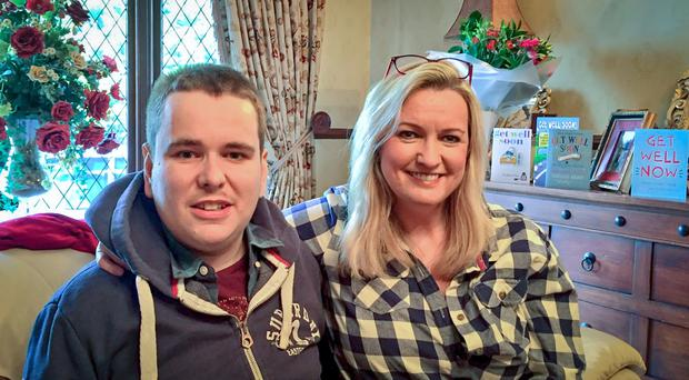 Mark Dobson with his mum Jo-Anne after they returned home following the operation