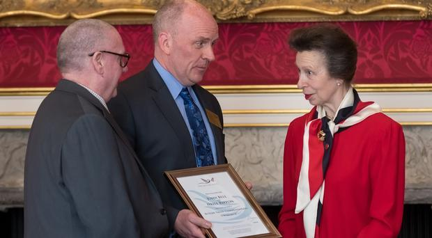 The Princess Royal presenting John Bell and Neil Rippon with their commendation